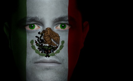 Mexican flag paintedprojected onto a mans face. Stock Photo