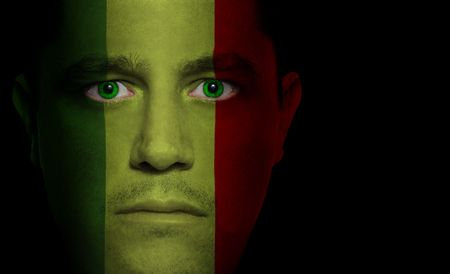 Malian flag paintedprojected onto a mans face photo