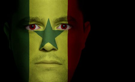 Senegalese flag paintedprojected onto a mans face photo