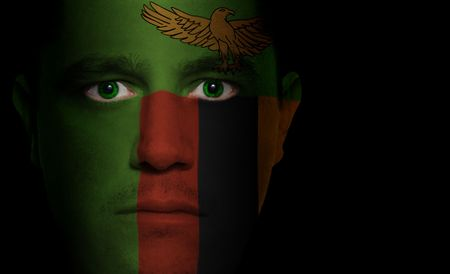 zambian flag: Zambian flag paintedprojected onto a mans face