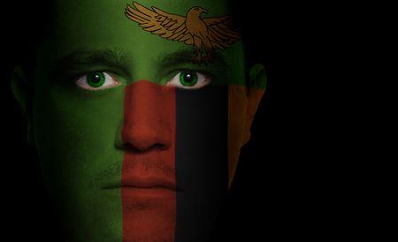zambian: Zambian flag paintedprojected onto a mans face