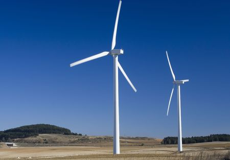 Two wind turbines standing in a field in central Spain. Stock Photo - 2067145