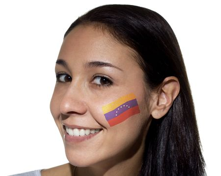 Smiling woman with a Venezuelan flag painted on her cheek. photo