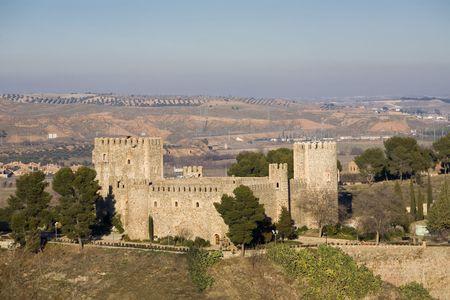 mudejar: San Servando castle (Castillo de San Servando) is a 14th century castle in mudejar style in Toledo, Castilla La Mancha, Spain. Stock Photo