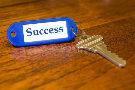 Closeup of a key with the word success on the label photo