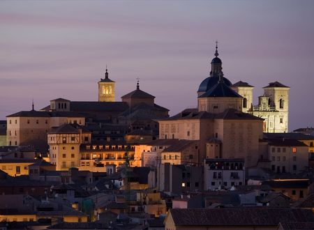 tome: View of Toledo, Spain with the churches of San Roman and Santo Tome at dusk Stock Photo