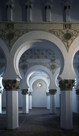 mudejar: Mudejar arches inside the Santa Maria la Blanca synagogue in Toledo, Spain.  Dates to the 13th century. Stock Photo