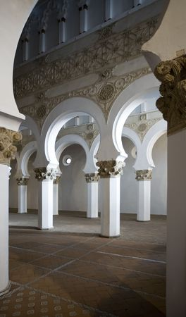 13th: Mudejar arches inside the Santa Maria la Blanca synagogue in Toledo, Spain.  Dates to the 13th century. Stock Photo