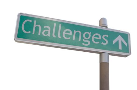 Street sign with an arrow and the word challenges