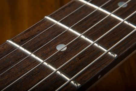 fret: Closeup of six string guitar fret board
