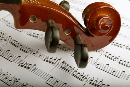 violins: Closeup of violin scroll with sheet music Stock Photo