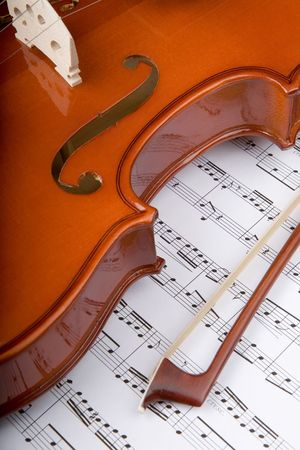 Closeup of violin with bow and sheet music