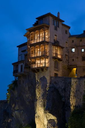 View of Cuenca, Spains Casas Colgadas (Hanging Houses) at dusk.  Cuenca is a UNESCO World Heritage Site.