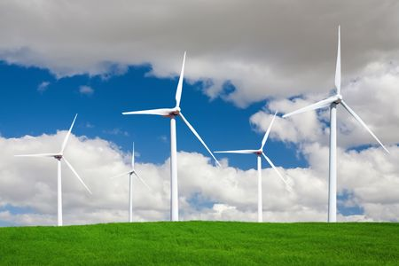 Wind turbines standing in a wheat field landscape in the spring Stock Photo - 3134315