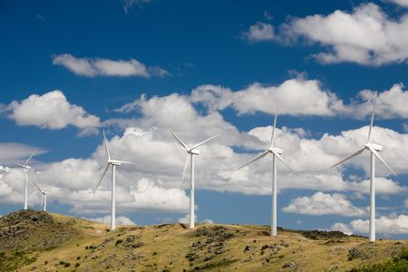 Wind turbines standing in the mountains of central Spain. photo