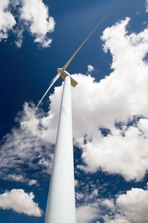 Wide angle shot of a wind turbine against a blue sky photo