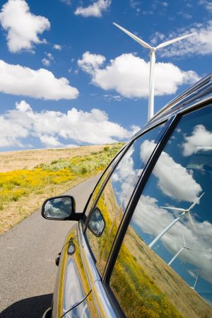 Green energy concept with wind turbines reflected in a car window Stock Photo - 3377589