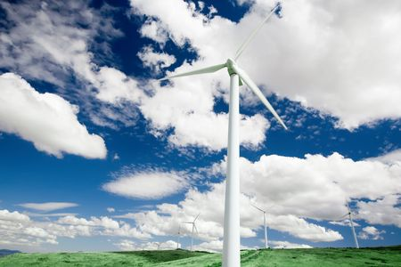 Wind turbines standing in a field in central Spain. photo