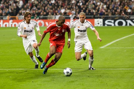 gabriel: MADRID - FEB. 25, 2009: Liverpool player Ryan Babel fights off Real Madrid players Pepe and Gabriel Heinze during their Champions League second round match.