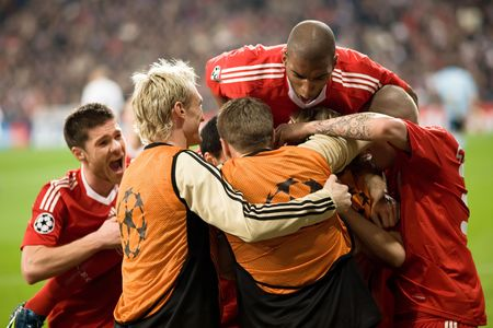 MADRID - FEB. 25, 2009: Liverpool players including Xabi Alonso, Sami Hyypia, Steven Gerrard, Ryan Babel and Martin Skrtel celebrate Yossi Benayouns winning goal during their Champions League second round match against Real Madrid.