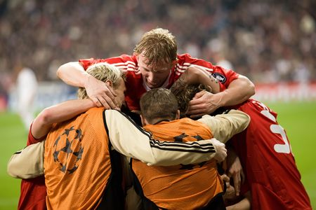 MADRID - FEB. 25, 2009: Liverpool players including Sami Hyypia, Steven Gerrard, Dirk Kuyt and Martin Skrtel celebrate Yossi Benayouns winning goal during their Champions League second round match against Real Madrid.