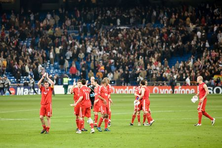 MADRID - FEB. 25, 2009: Liverpool players celebrate after their 1-0 victory against Real Madrid in their Champions League second round match.