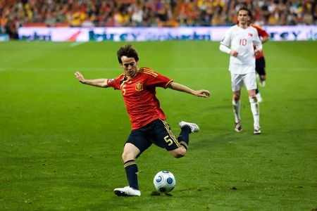 silva: MADRID - MAR. 28, 2009: Spains David Silva crosses the ball during the second half of their 1-0 victory over Turkey in their World Cup Qualifier.