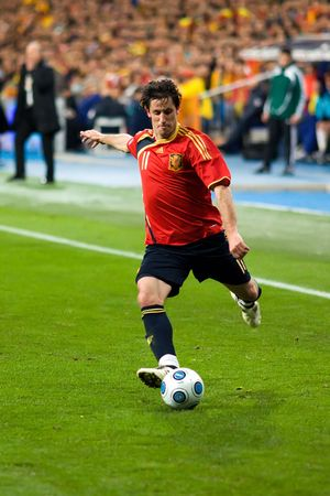 MADRID - MAR. 28, 2009: Spains Juan Capdevila crosses the ball during the second half of their 1-0 victory over Turkey in their World Cup Qualifier.
