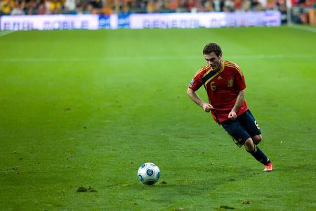 MADRID - MAR. 28, 2009: Spains Juan Manuel Mata crosses the ball during the second half of their 1-0 victory over Turkey in their World Cup Qualifier.