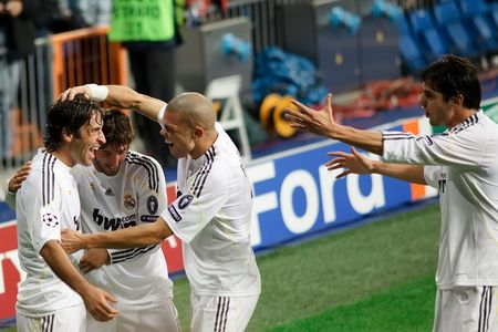 to pepe: MADRID - OCT. 21, 2009: Real Madrids Raul Gonzalez, Esteban Granero, Pepe, and Kaka celebrate Rauls goal during their 2-3 loss against AC Milan in Champions League group stage action. Editorial