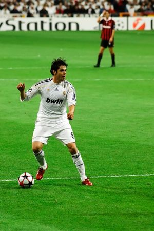 teammate: MADRID - OCT. 21, 2009: Real Madrids Kaka looks for a teammate during their 2-3 loss against AC Milan in Champions League group stage action. Editorial