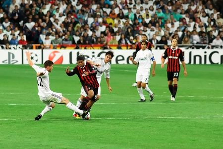 MADRID - OCT. 21, 2009: AC Milans Ronaldinho attempts to beat Xabi Alonso during Milans 3-2 victory over Real Madrid in Champions League group stage action.