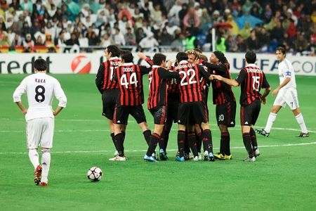 MADRID - OCT. 21, 2009: A dejected Madrid and former AC Milan midfielder Kaka walks by Milan players celebrating the first goal of Milans 3-2 victory over Real Madrid in Champions League group stage action.