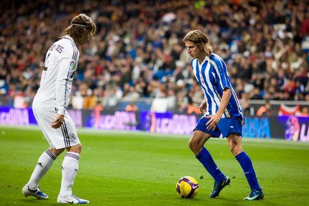 sergio: MADRID - JAN. 25, 2009: Filipe Luis Kasmirski of Deportivo La Coruna attempts to beat Real Madrids Sergio Ramos during a Spanish First Division league match.