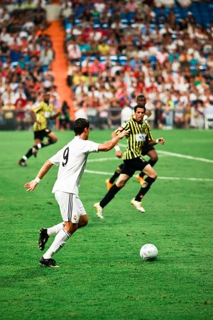 MADRID - JUL. 26, 2009: Cristiano Ronaldo prepares a cross in his first match in the Santiago Bernabeu stadium during Real Madrid's 1-1 draw with Al Ittihad in the Peace Cup. Stock Photo - 6886852