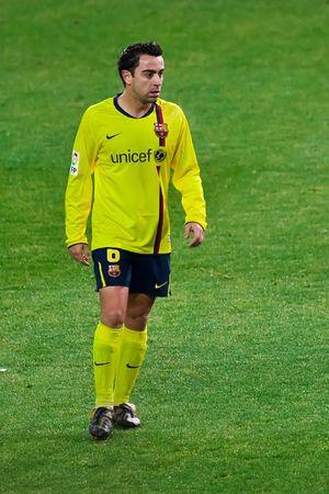 xavi: FEB. 14, 2010 - Barcelona player Xavi Hernandez during Atletico Madrids 2-1 victory over FC Barcelona in Madrid, Spain. Editorial
