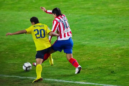 FEB. 14, 2010 - Kun Aguero and Jeffren fight for the ball during Atletico Madrid's 2-1 victory over FC Barcelona in Madrid, Spain. Stock Photo - 6889289