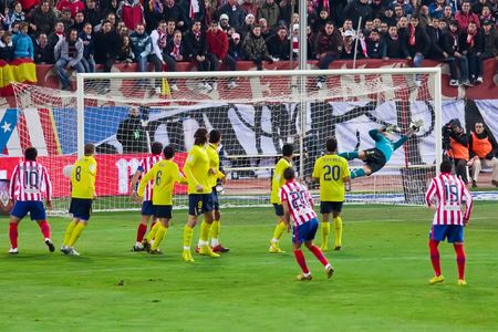 iniesta: FEB. 14, 2010 - Atletico Madrid player Simao Sabrosa scores a goal during Atletico Madrids 2-1 victory over FC Barcelona in Madrid, Spain.
