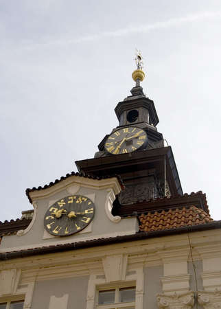 jewish town: Jewish Town Hall in Prague with its two clocks, one with Roman numerals and the other with Hebrew numbers. Stock Photo
