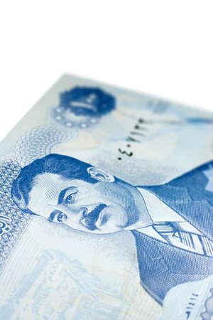 iraqi: Close-up of one hundred Iraqi dinars banknote.  Features Saddam Hussein.