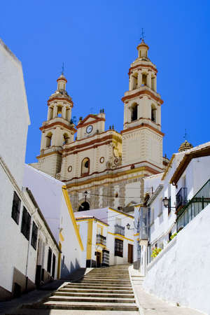 neoclassic: Olvera is a white village (pueblo blanco) in Cadiz province, Andalucia, Spain.  It features a moorish fortress and a neoclassic cathedral overlooking the whitewashed village. Stock Photo