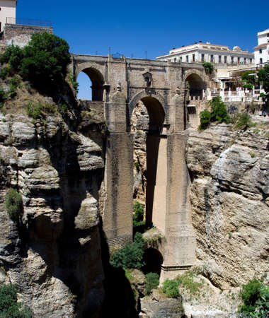 chasm: The Puente Nuevo (new bridge) in Ronda, Spain spans the 120m deep chasm which divides the city. Stock Photo