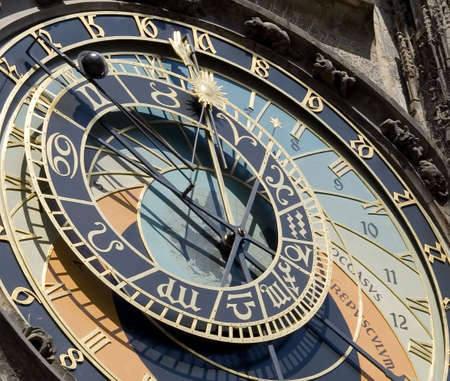 The Prague Astronomical Clock (Prague Orloj) is a medieval astronomical clock dating back to 1410 located in Prague, Czech Republic. The Orloj is mounted on the southern wall of Old Town City Hall in the Old Town Square. Stock Photo