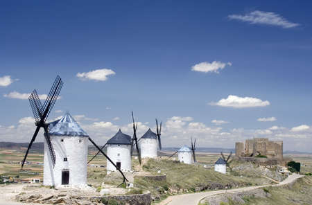 toledo town: Medieval windmills dating from the 16th century on a hill overlooking the town of Consuegra in Toledo province, Castilla La Mancha, central Spain.  Made famous in Miguel de Cervantes Saavedras novel Don Quijote de la Mancha, these windmills are situated
