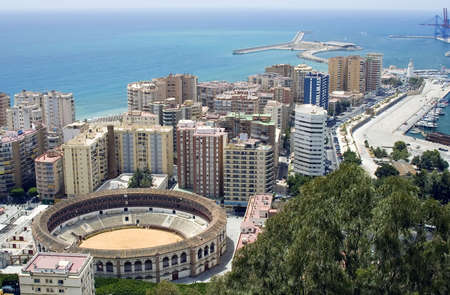 malaga: View of Malaga, Spain with the Plaza de Toros (bullring) in the foreground.