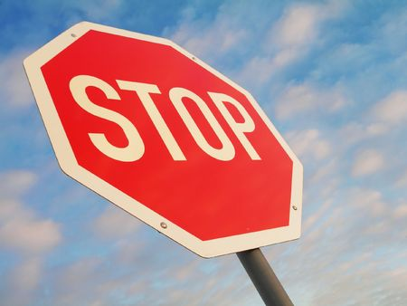 stop sign against blue light clouded sky photo