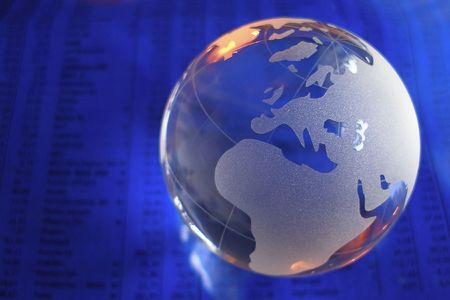 conceptional: glass globe in front of business numbers Stock Photo