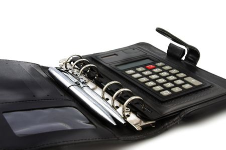 A black leather diary with calculator and two silver pens inside. photo