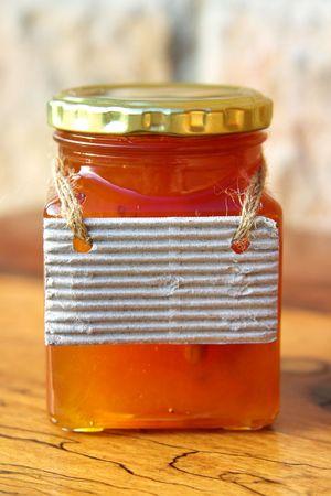 Honey jar with a tag.