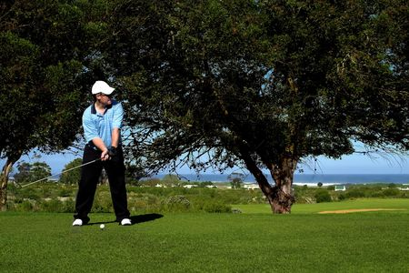 Golfer preparing to hit the ball on the tee box. photo